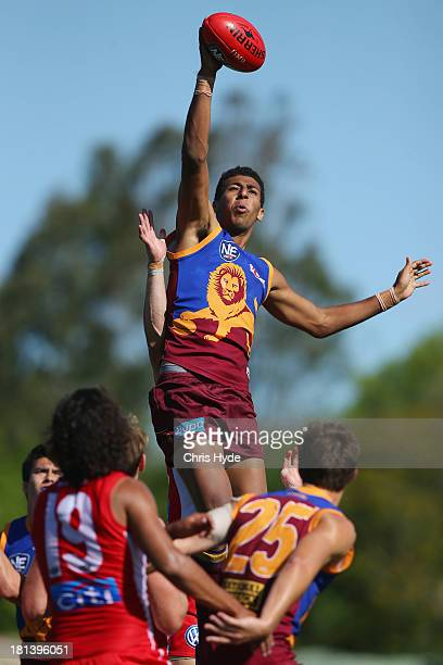 Archie Smith of the Lions reaches for the ball during the 2013 NEAFL Grand Final match between the Brisbane Lions and the Sydney Swans at Apsley Oval...
