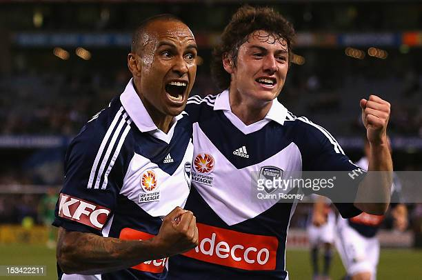 Archie Thompson and Marco Rojas of the Victory celebrate a goal during the round one ALeague match between the Melbourne Victory and the Melbourne...