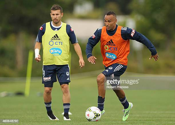 Archie Thompson controls the ball as Kosta Barbarouses looks on during a Melbourne Victory A-League training session at Gosch's Paddock on December...