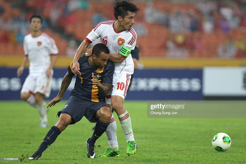 Archie Thompson of Australia compete for the ball with Zheng Zhi of China during the EAFF East Asian Cup match between Australia and China at Jamsil Stadium on July 28, 2013 in Seoul, South Korea.