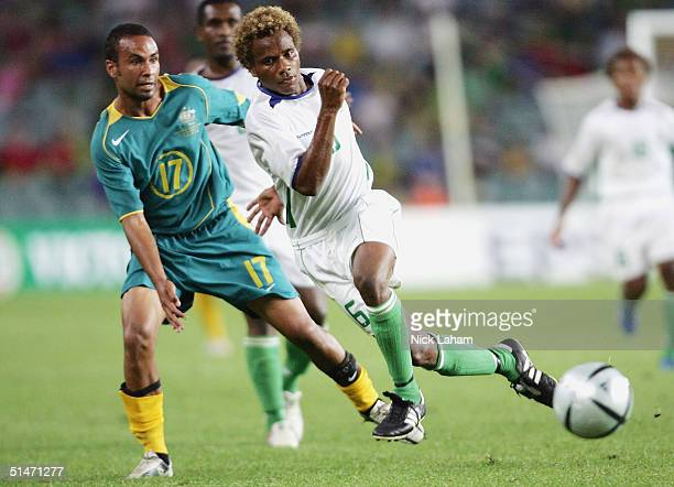 Archie Thompson of Australia is challenged by Sale Kilifa of the Solomon Islands during the Oceania Nations Cup and the Confederations Cup last...