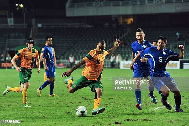 Archie Thompson of Australia kicks the ball during the EAFF East Asian Cup 2013 Qualifying match between Guam and Australia at Hong Kong Stadium on...