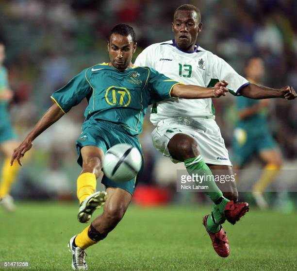 Archie Thompson of Australia shoots for goal against George Lui of the Solomon Islands during the Oceania Nations Cup and the Confederations Cup last...