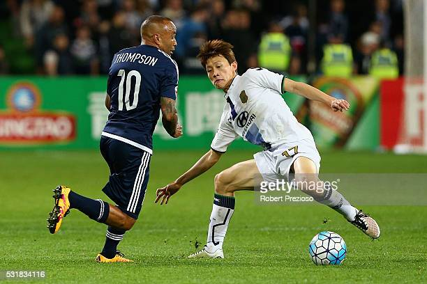 Archie Thompson of Melbourne and Lee Jae Sung of Jeonbuk contest the ball during the AFC Champions League match between the Melbourne Victory and...