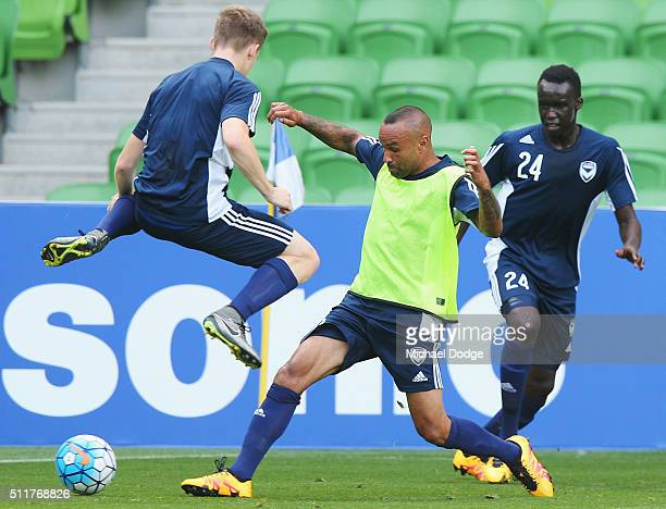 Archie Thompson of the Victory and Scott Galloway compete for the ball during a Melbourne Victory training session at AAMI Park on February 23 2016...