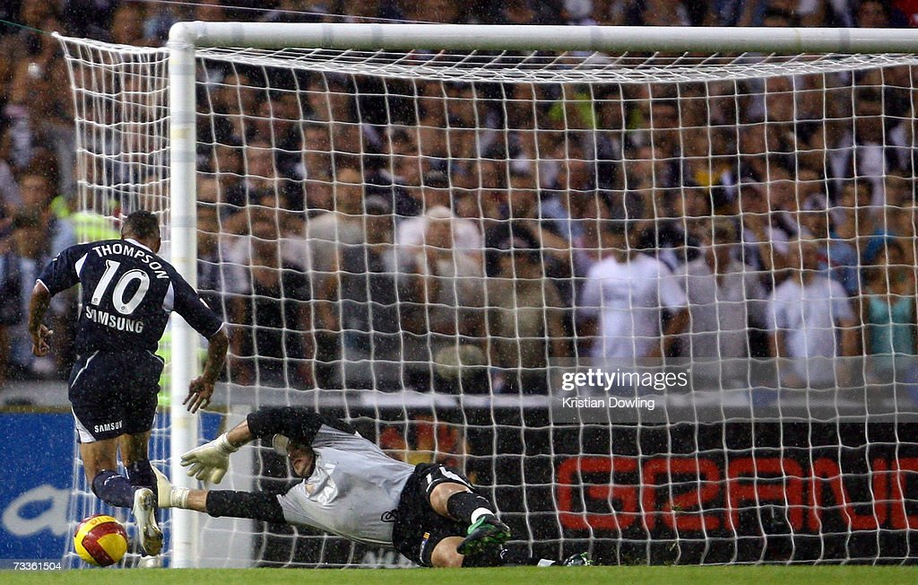 Archie Thompson of the Victory attacks for goal against Adelaide United goalkeeper Daniel Beltrame during the Hyundai A-League Grand Final between the Melbourne Victory and Adelaide United at the Telstra Dome February 18, 2007 in Melbourne, Australia.