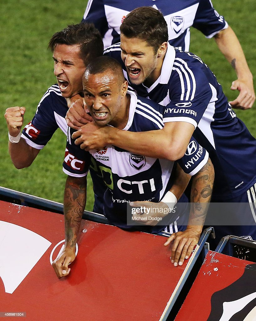 Archie Thompson (C) of the Victory celebrates a goal during the round one A-League match between Melbourne Victory and the Western Sydney Wanderers at Etihad Stadium on October 10, 2014 in Melbourne, Australia.