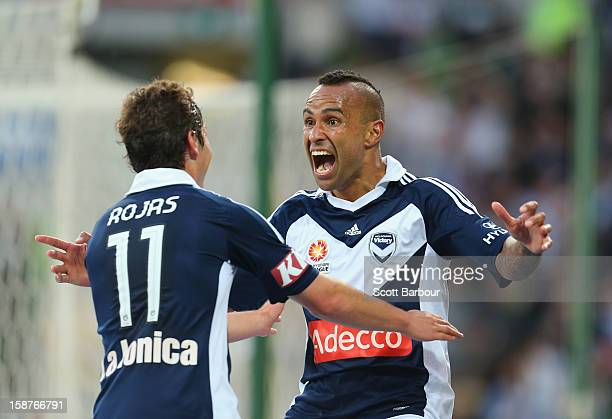Archie Thompson of the Victory celebrates after he scored his teams second goal with Marco Rojas during the round 13 ALeague match between the...