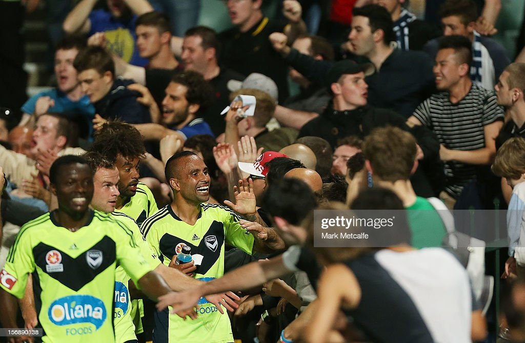 Archie Thompson of the Victory celebrates with fans after victory during the round eight A-League match between the Western Sydney Wanderers and the Melbourne Victory at Parramatta Stadium on November 24, 2012 in Sydney, Australia.