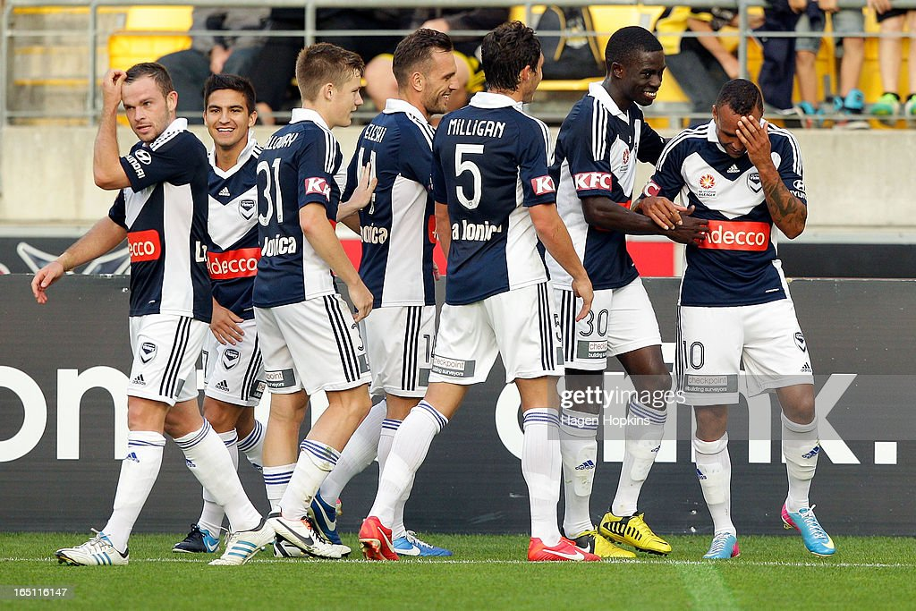 Archie Thompson (R) of the Victory is congratulated on his goal by teammates during the round 27 A-League match between the Wellington Phoenix the Melbourne Victory at Westpac Stadium on March 31, 2013 in Wellington, New Zealand.