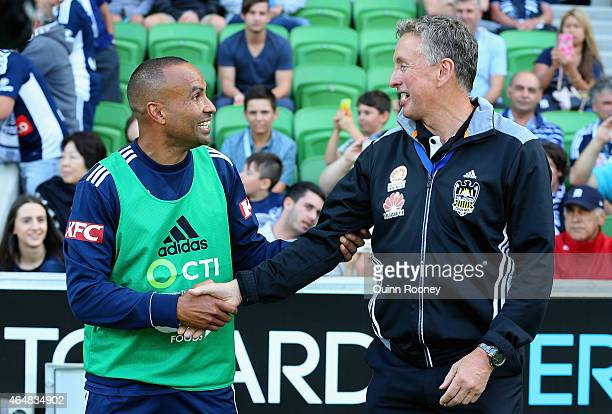 Archie Thompson of the Victory shakes hands with Ernie Merrick the Phoenix coach during the round 19 ALeague match between the Melbourne Victory and...