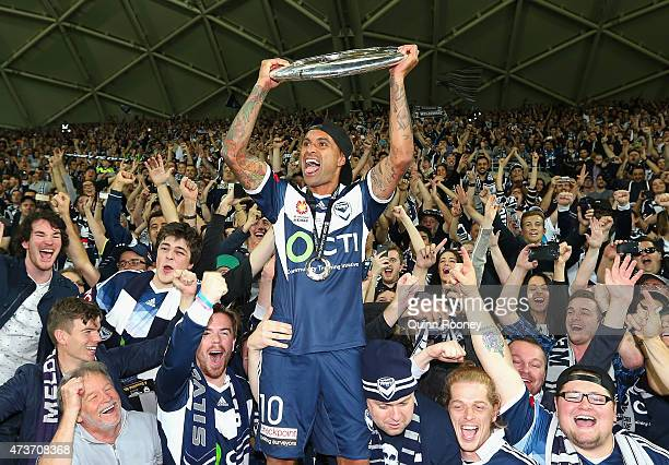 Archie Thompson of the Victory shows the trophy to the crowd after the Victory won the 2015 ALeague Grand Final match between the Melbourne Victory...