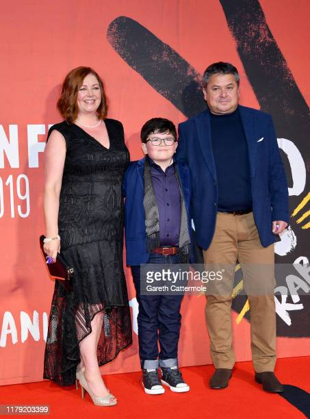 Archie Yates and parents attend the JoJo Rabbit European Premiere during the 63rd BFI London Film Festival at Odeon Luxe Leicester Square on October...