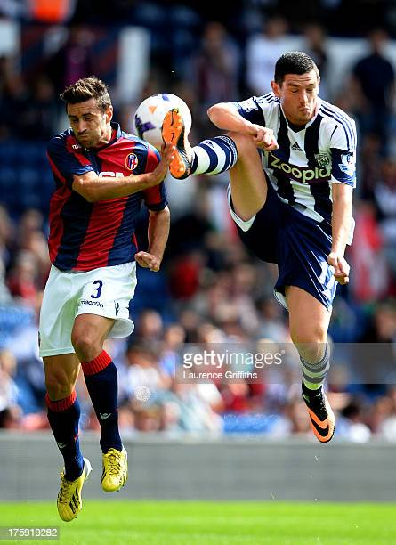 Archimede Morleo of Bologna battes with Graham Dorrans of West Bromwich Albion during a Pre Season Friendly between West Bromwich Albion and Bologna...