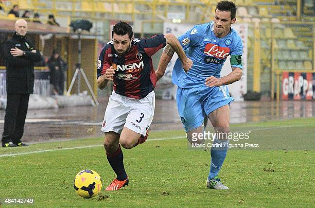 Archimede Morleo of Bologna FC competes the ball with Christian Maggio of SSC Napoli during the Serie A Bologna FC and SSC Napoli at Stadio Renato...