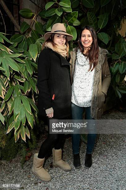 Architech Cristina Planell is wearing a Primak hat Mango coat Parfois scarf UGG boots and a vintage handbag and Barbara Garcia is wearing a Mango...
