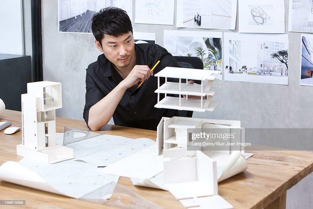 Architect and architectural model : Stock Photo