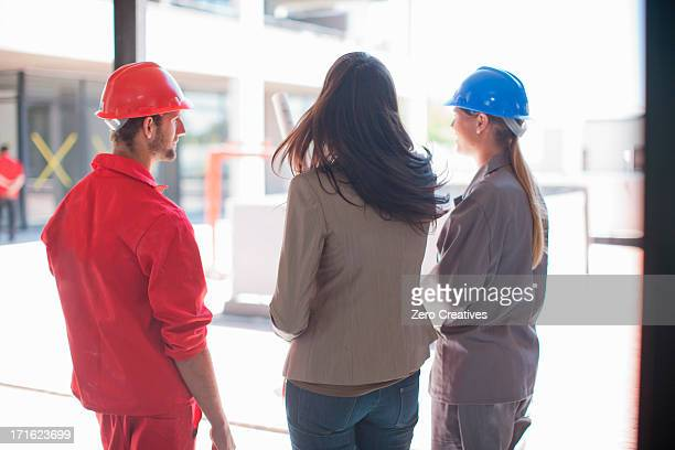 Architect and building contractors talking