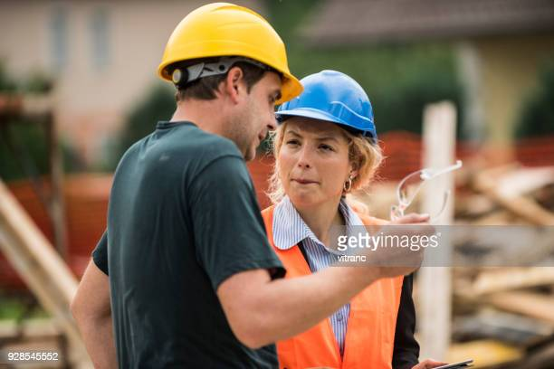 architect and construction worker - hard hat stock pictures, royalty-free photos & images