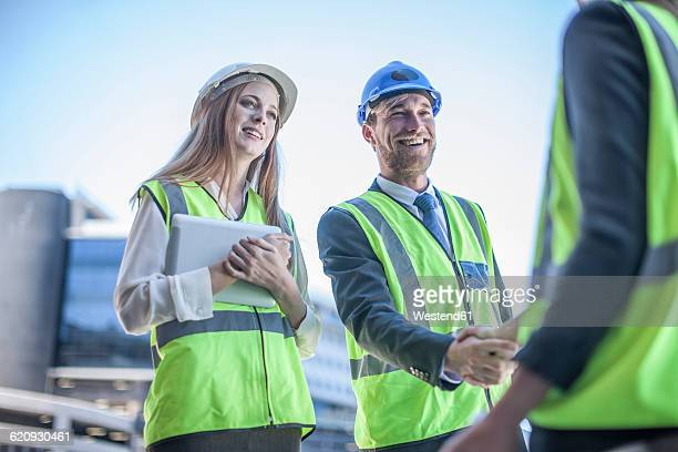 Architect and engineer at construction site discussing project