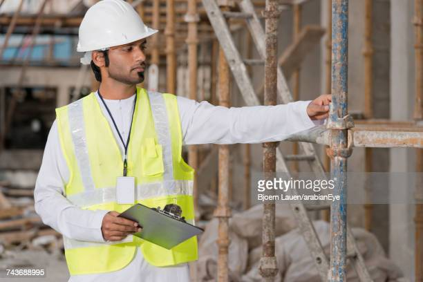 Architect at construction site.,Architect at construction site.