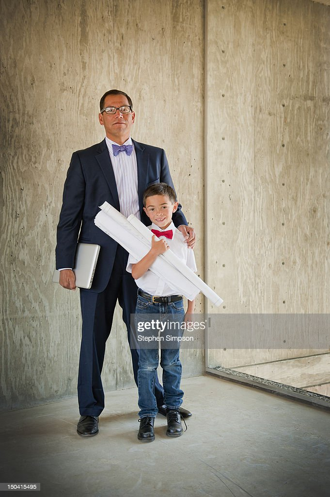 architect at work on site with his son : Stock Photo