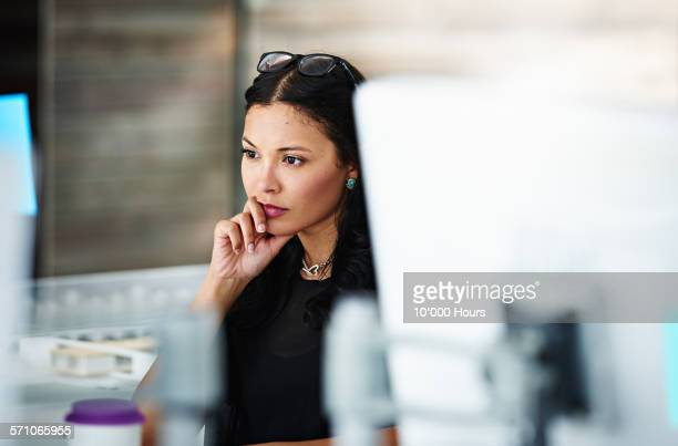 architect at workstation contemplating the project - leanincollection stock pictures, royalty-free photos & images