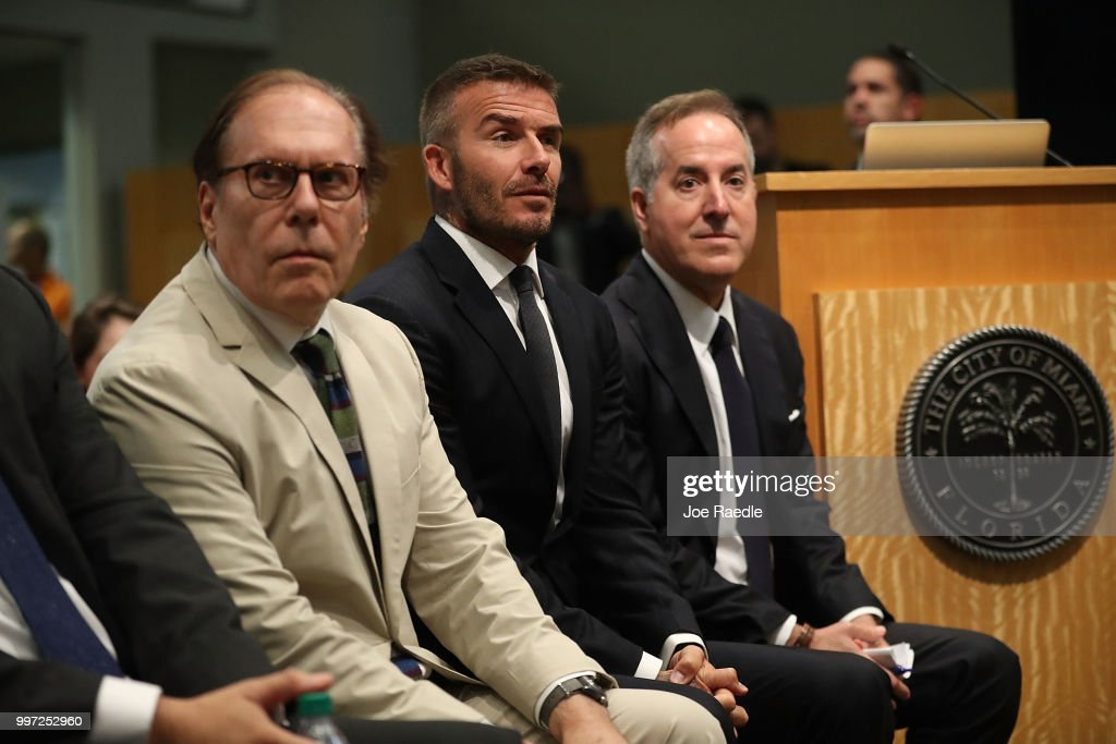 Architect Bernardo Fort-Brescia, David Beckham and Jorge Mas (L-R) attend a pubic hearing at the Miami City Hall about building a Major League soccer stadium on a public golf course on July 12, 2018 in Miami, Florida. Mr. Beckham and his partners attended the meeting at city hall during a public hearing in their efforts to build a Major League Soccer stadium in the City of Miami for their professional soccer team.
