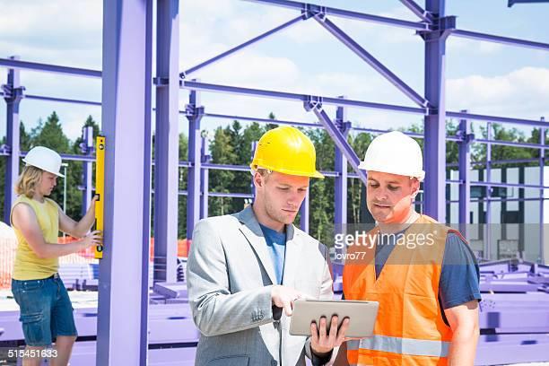 Architect checking plans