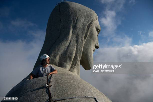Architect Cristina Ventura, who is in charge of the Christ the Redeemer statue restoration, looks out from the top of the Christ the Redeemer statue...