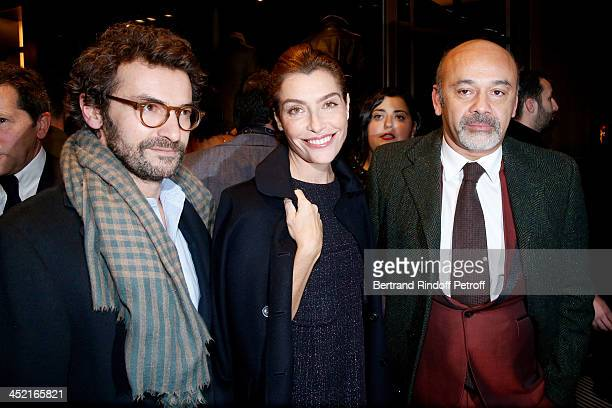 Architect Cyril Vergniol journalist Daphne Roulier and Christian Louboutin attend Berluti Flagship Store Opening on November 26 2013 in Paris France