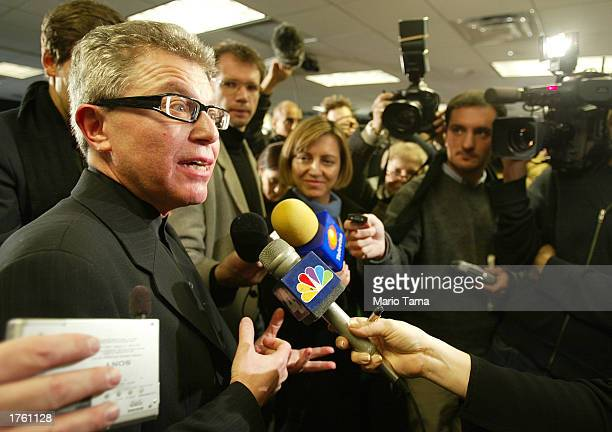 Architect Daniel Libeskind speaks to reporters about his proposal for the rebuilding of New York's World Trade Center site February 4 2003 in New...