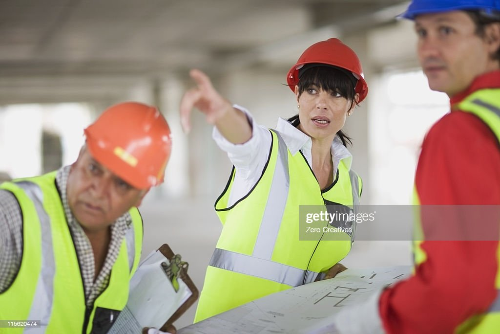 Architect discussing construction : Stock Photo
