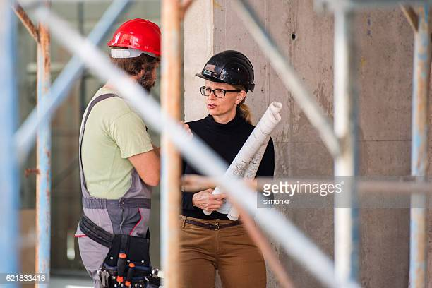 Architect discussing with worker