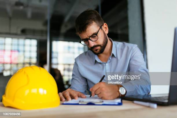 architect doing some work at office - human body part stock pictures, royalty-free photos & images