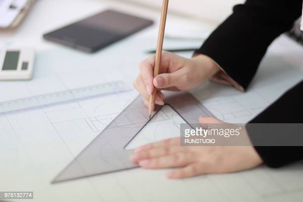 architect drafting blueprint with ruler and pencil - 建築家 ストックフォトと画像