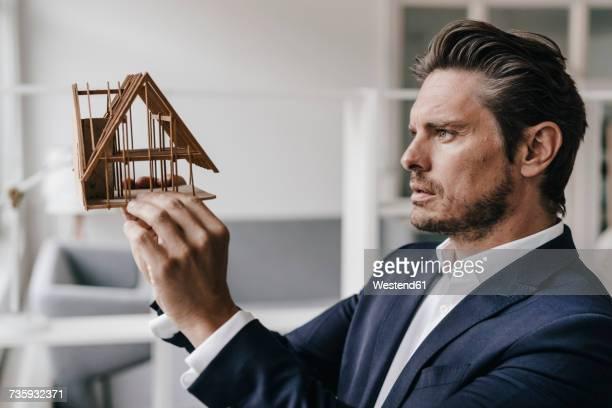 Architect examining architectural model