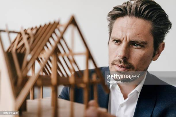 architect examining architectural model - konzentration stock-fotos und bilder