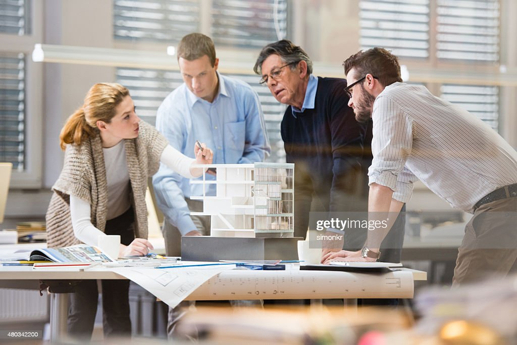 Architect explaining project plan to client : Stock Photo