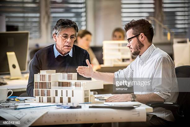 architect explaining project plan to project manager - model building stock photos and pictures
