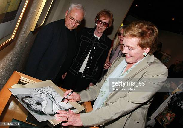 Architect Frank Gehry actresses Carol Burnett Jennifer Edwards and Julie Andrews attend Blake Edwards' art exhibit preview at Leslie Sacks Fine Art...