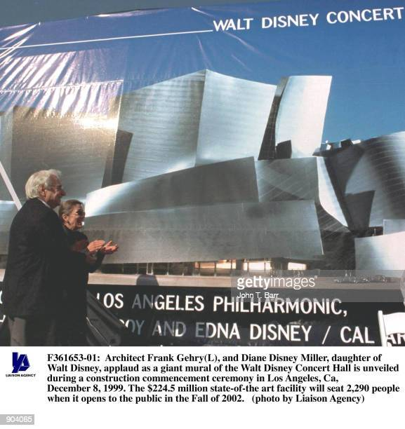 Architect Frank Gehry and Diane Disney Miller daughter of Walt Disney applaud as a giant mural of the Walt Disney Concert Hall is unveiled during a...