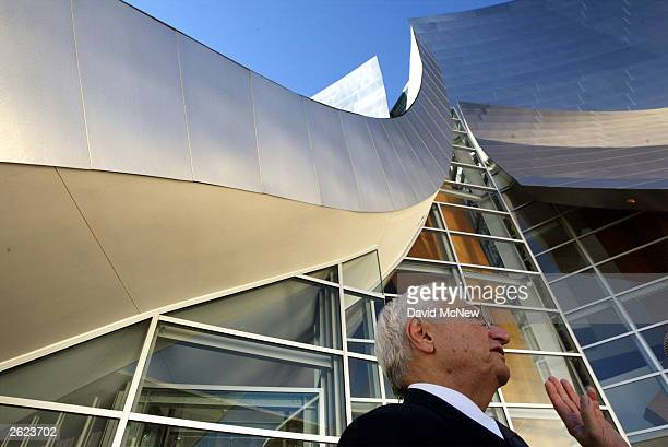 Architect Frank Gehry is seen outside the Walt Disney Concert Hall at the hall's dedication October 20 2003 in Los Angeles California The 2265seat...