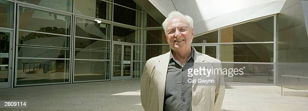 Architect Frank Gehry poses for a portrait August 14 2003 in front of the Walt Disney Concert Hall which he designed and which is scheduled to open...