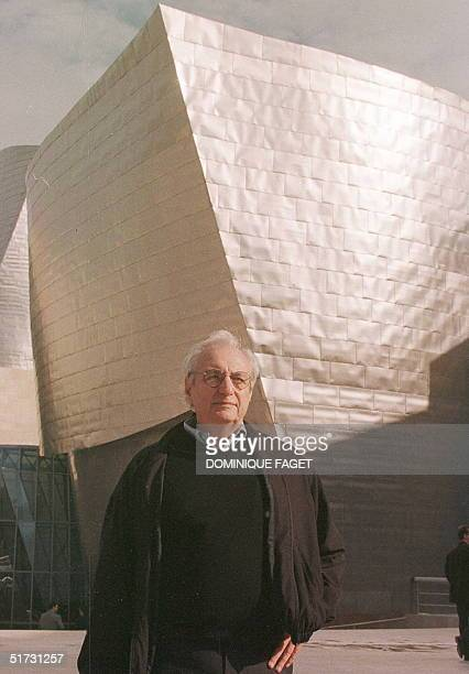 Architect Frank O Gehry poses in front the Guggenheim museum that he conceived before the first press visit in Bilbao 15 October The official opening...