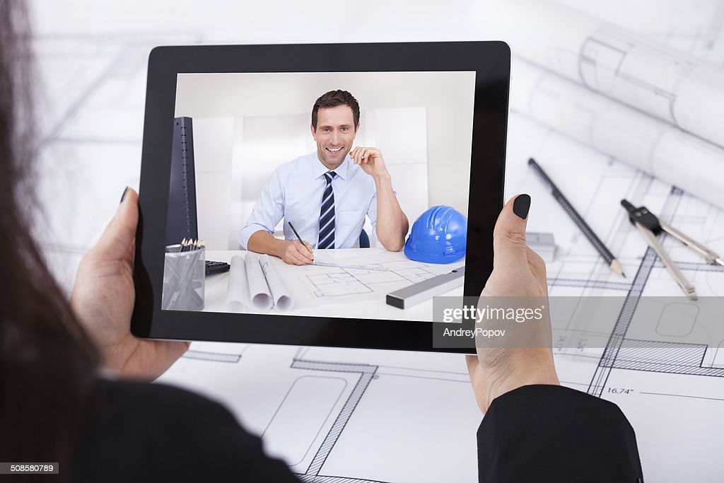Architect Having Video Conference : Stock Photo