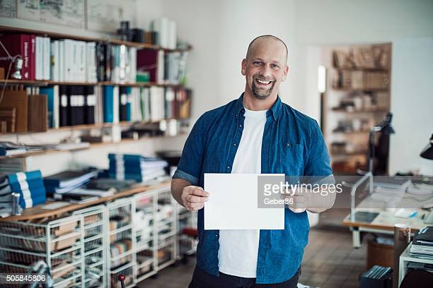 Architect  holding blank board