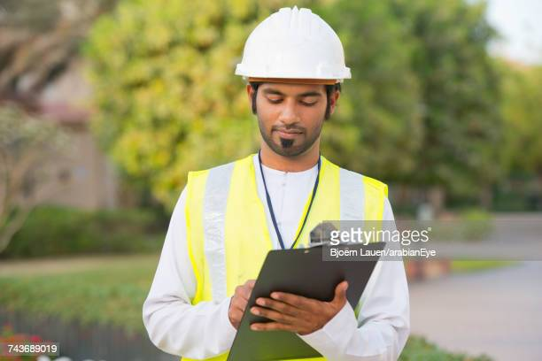 Architect holding clipboard.