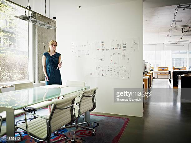 Architect holding digital tablet in office