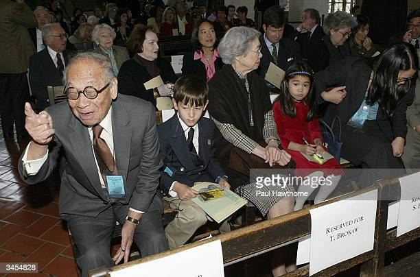Architect IM Pei gestures towards the stage as he sits with family members before being honored with an Ellis Island Family Heritage Award at the...